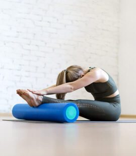 Woman in folded yoga pose.